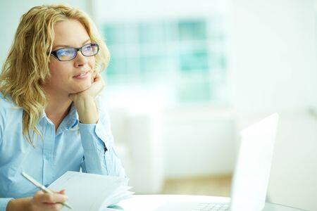 competitive business: Portrait of smart businesswoman thinking during work Stock Photo