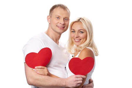 man woman hugging: Portrait of happy couple holding paper hearts Stock Photo