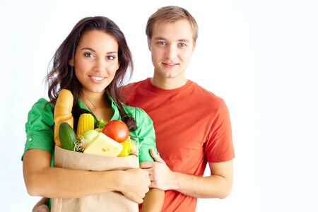 Happy couple of healthy eating followers looking at camera photo