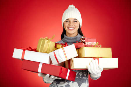 Portrait of happy girl with giftboxes looking at camera Stock Photo - 16611994