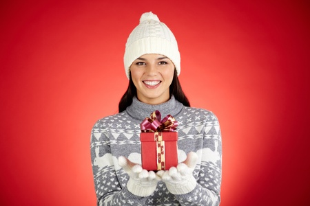 Portrait of happy girl with giftbox looking at camera Stock Photo - 16611999