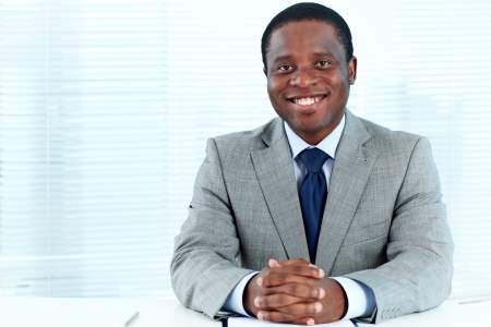 Portrait of confident African businessman looking at camera in office photo