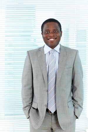 Portrait of African businessman looking at camera with smile Stock Photo - 16730170
