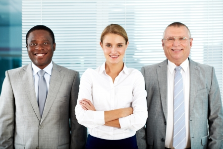 Portrait of three business partners looking at camera with smiles Stock Photo - 16730196