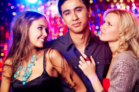 Image of happy girls and guy clubbing together at party photo