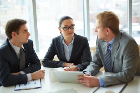 Image of group of employees discussing new ideas or project at meeting Stock Photo - 16730247