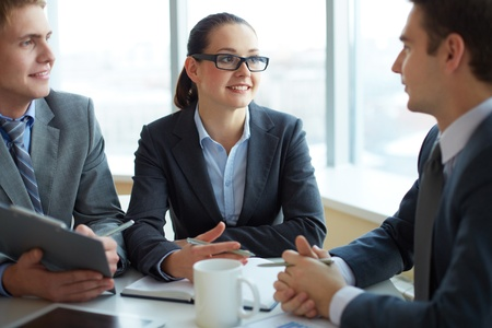 Image of two employees listening to young man at interview Stock Photo - 16730231