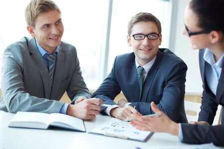 Image of two employees looking at businesswoman explaining her idea at meeting Stock Photo - 16730252
