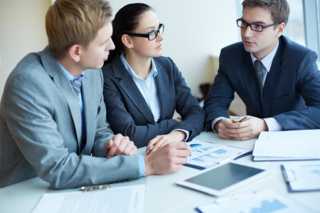 Image of three business people negotiating at meeting Stock Photo - 16730158