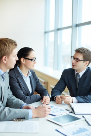 Image of three business people negotiating at meeting Stock Photo - 16730178