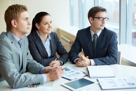 Image of three business people looking in the window at meeting Stock Photo - 16730189