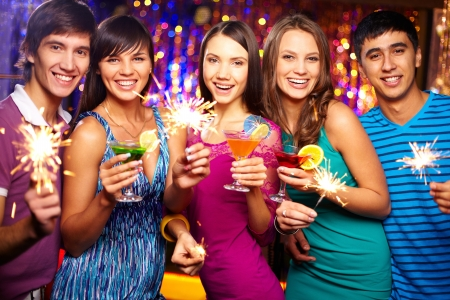 holiday gathering: Portrait of joyful friends toasting at New Year party Stock Photo