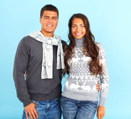 pullovers: Portrait of happy couple in fashionable pullovers looking at camera  Stock Photo