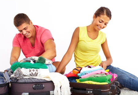 packing suitcase: Portrait of cute girl and handsome man preparing for journey