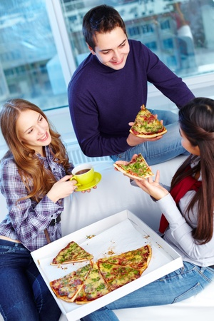 Image of teenage friends eating pizza together Stock Photo - 16848785