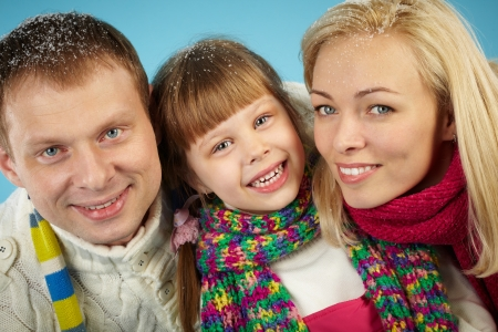 Happy parents and their daughter looking at camera with smiles Stock Photo - 16848769