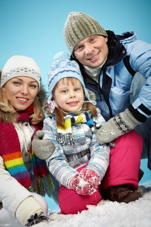 Happy parents and their daughter in winterwear looking at camera with smiles Stock Photo - 16848770