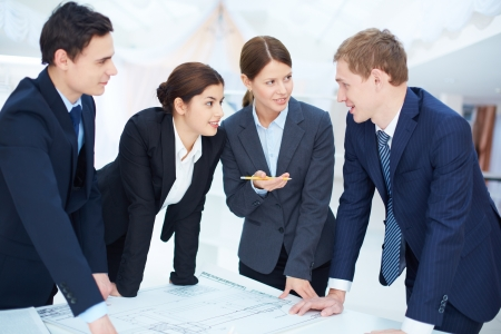 Team of engineers discussing blueprint at meeting Stock Photo - 16848840