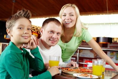 Portrait of a happy family having lunch at the cafe Stock Photo - 16848907