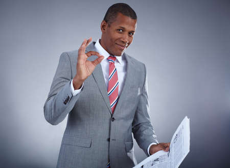 Portrait of successful professional in suit holding newspaper Stock Photo - 16848799