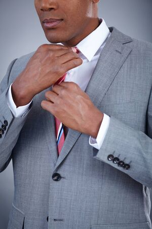 Close-up of smart businessman touching his necktie Stock Photo - 16848794