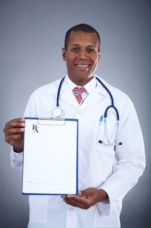 Portrait of confident doctor showing prescription blank Stock Photo - 16848932