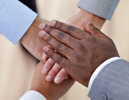 Above angle of pile of hands of business partners Stock Photo - 16963817
