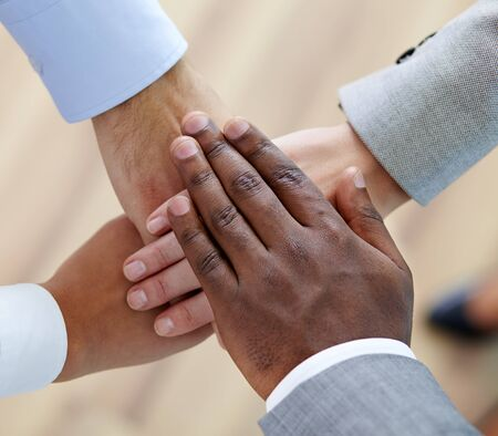Above angle of pile of hands of business partners Stock Photo - 17083868