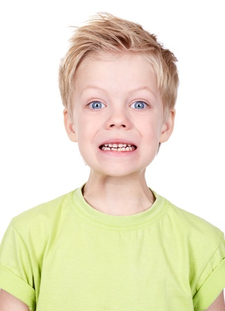 angry blonde: Portrait of a cute little boy posing for camera isolated on white background