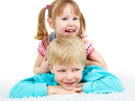 Two happy kids lying on the floor and laughing photo