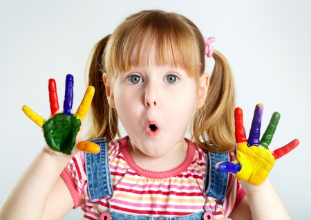 Girl having fun, her palms covered with paint Stock Photo - 17088250