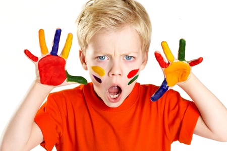 Boy having palms and face covered with paint
