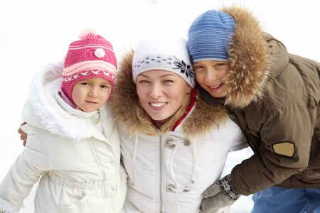 Happy kids and their mother in winterwear looking at camera Stock Photo - 17086829