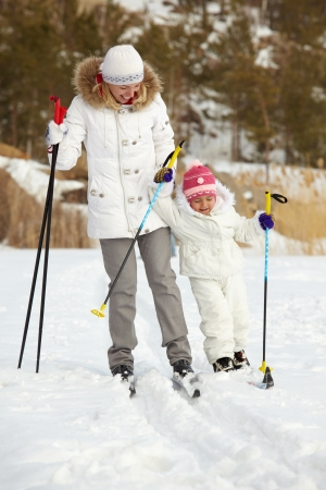 Little girl and her mother skiing in park Stock Photo - 17087959