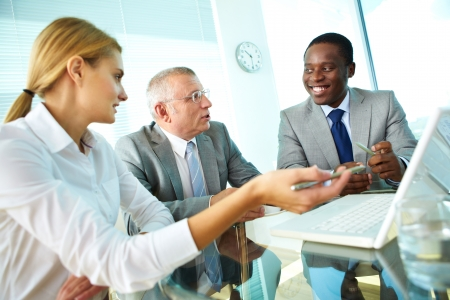 Portrait of pretty secretary, boss and employee discussing their ideas Stock Photo - 17154148