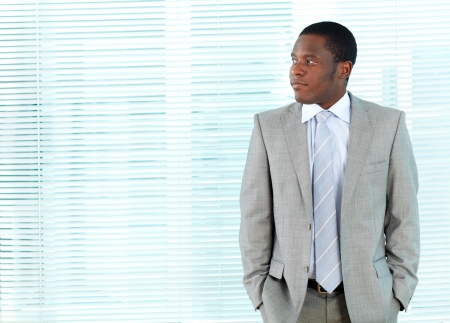 Portrait of smart African businessman in office photo