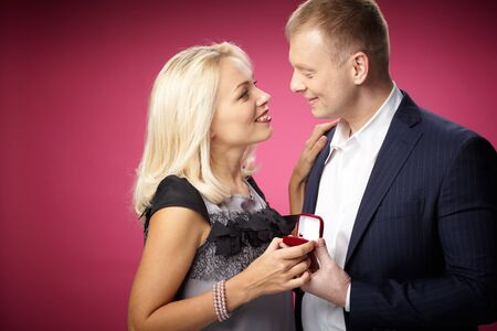 Elegant man making proposal to beautiful woman Stock Photo - 17154076