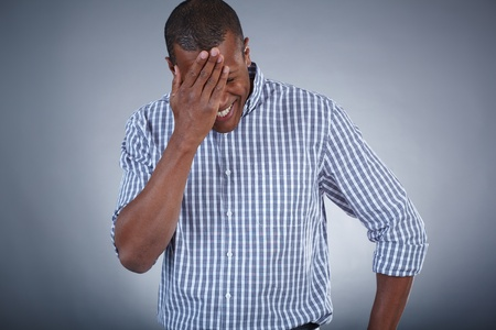 oops: Image of young African man touching his head in surprise Stock Photo