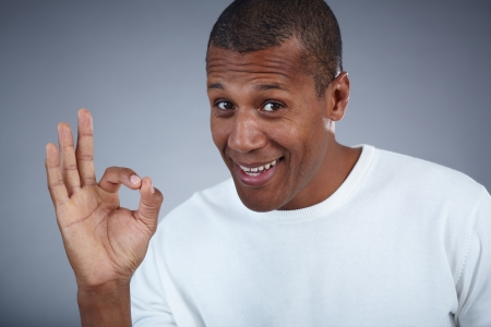 Image of young African man looking at camera while showing ok sign Stock Photo - 17154146