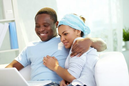 amorous woman: Lovely couple enjoying online communication
