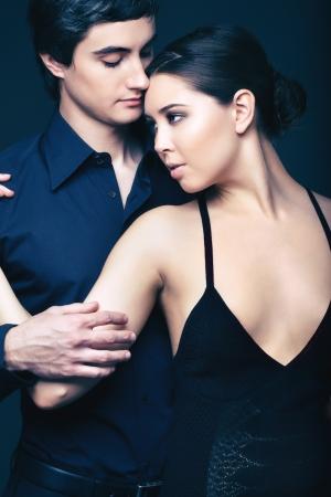 Vertical shot of an elegant couple wearing black Stock Photo - 17257579