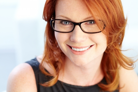 redhaired: Close-up portrait of a red-haired beauty with a charming smile Stock Photo