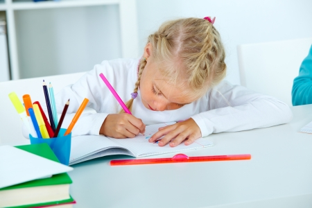 diligent: Diligent pupil drawing in her workbook