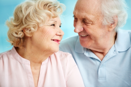 happy old people: Senior couple exchanging affectionate looks