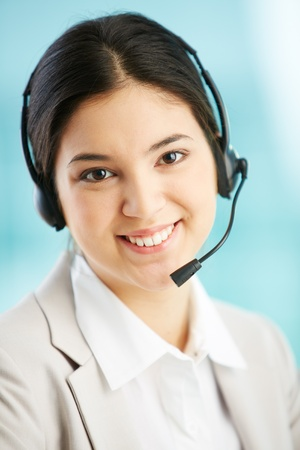 Vertical portrait of a smiling helpdesk lady being ready to consult the client Stock Photo - 17288112