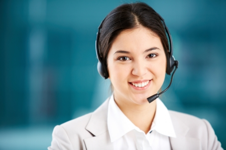 Portrait of a young customer support representative consulting the client Stock Photo - 17343435