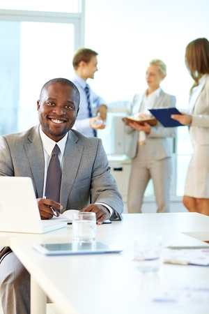Portrait of happy boss looking at camera in working environment Stock Photo - 17340581
