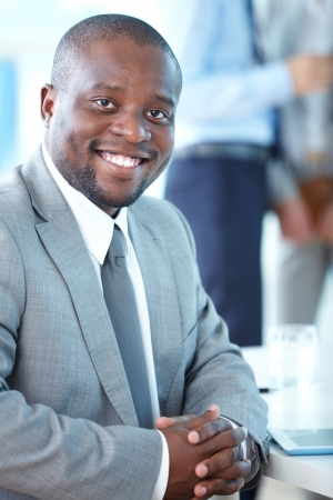 Portrait of attractive businessman looking at camera in working environment Stock Photo - 17340336