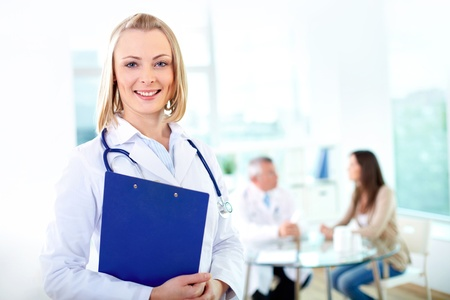 Portrait of pretty female practitioner looking at camera in working environment Stock Photo - 17340579
