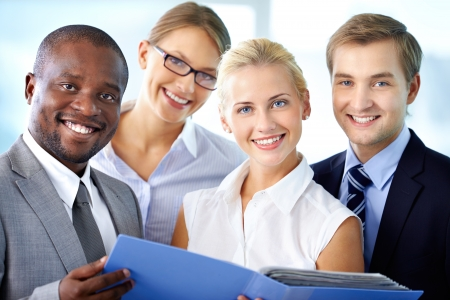 Portrait of happy business team looking at camera with smiles Stock Photo - 17340340